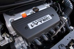 "Image of 2012 Honda Civic Si Engine with large letters ""DOHC"" standing for Dual OverHead Cams"