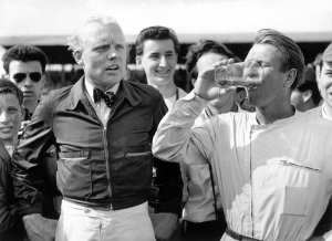 Collins drinking a pint with Hawthorn 58 British GP